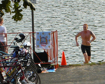 Photo of the 1st guy out of the water at the Midwest Mayhem Triathlon at Lone Star Lake.