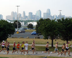 Photo of the KC skyline behind the racers at the Cancer Action 5K.