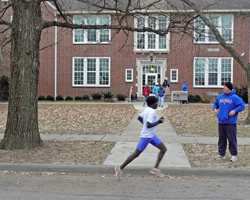Photo of Benson Chesang in front of Woodlawn School on Thanksgiving Day.