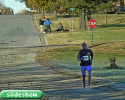 Photo of Benson Chesang with a huge lead at the November 6th Turkey Trot at Haskell and link to slideshow.