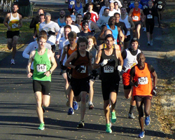 Photo of the leaders on 4th St at the runLawrence Thanksgiving Day 5K.