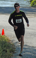 Photo of Tim Testa about half mile from finish of the Sandrat Trail Race.