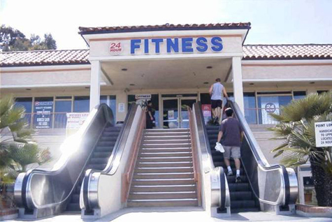 Photo of Point Loma Fitness Center with entrance with steps and outdoor escalator.