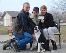 Photo of Gary Henry, Sherrie Klover presenting a check to Doiri Villalon, Lawrence Humane Society from the Sanders' Saunter Trail Run.