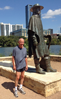 Photo of John Huchingson in Austin with Stevie Ray Vaughn.