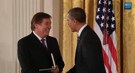 Photo of Billy Mills receiving the Presidential Cirtizens Medal from President Obama.