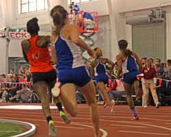 Photo of the women's 600 meter chasing Paris Daniels around the first curve.