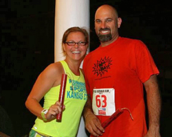 LaRisa and Brian Lochner with their winners' dynamite sticks from the Iola Mad Bomber 5K.
