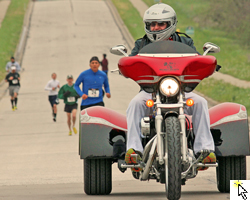 Red Dog Gardner on his motortrike leading the Run to Remember 5K on May 5, 2013 and link to the FLickr slideshow.