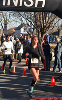 Emily Venters, 1st overall female at the runLawrence Thanksgiving Day 5K.