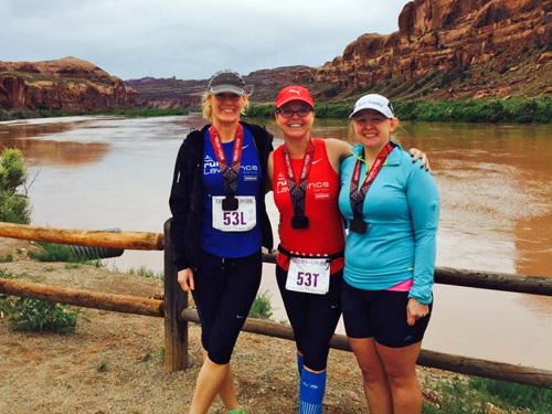 Photo of LaRisa Chambers and friends at the Thelma and Louise Half Marathon.