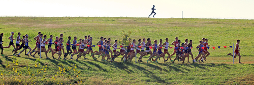 Photo from the Rim Rock Classic men's 8K.  Pack going past John Lawson.