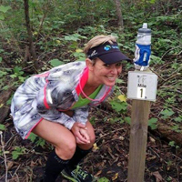 Photo of Tesa Green at mile 99 at the Hawk 100.