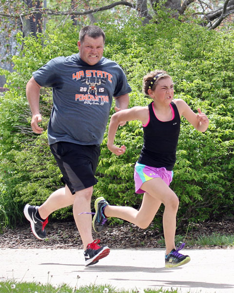 Sprinting to the finish and for family pride at the Sunflower Marthon CLub 5K on April 17, 2016.