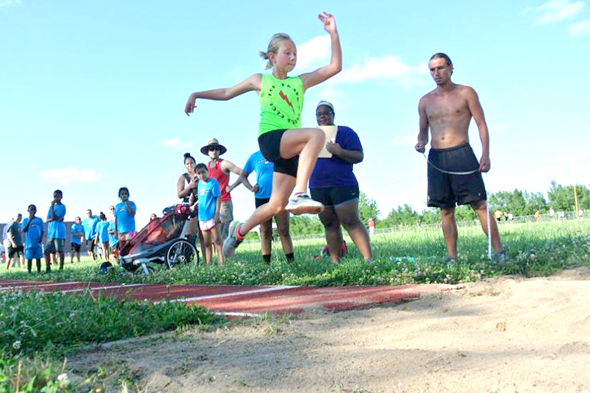 Photo of the long jump competition at the Mini Mocs vs TBC Track Club meet.