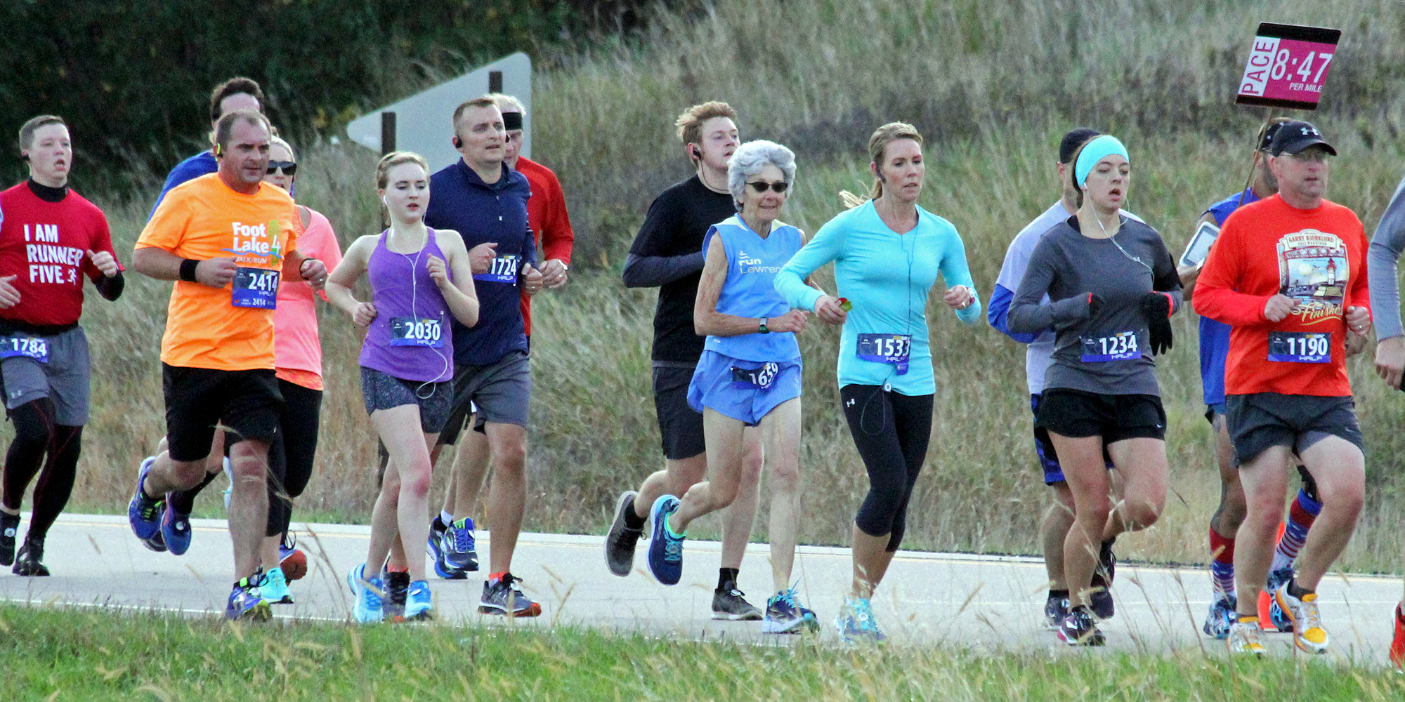 Dee Boeck with the 1:55 pace group in the Mankato Half Marathon.