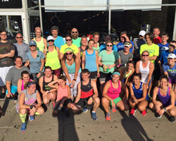 Photo of Mass Street Milers in front of Ad Astra.