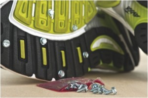 Photo of screws in running shoes to get traction on ice.